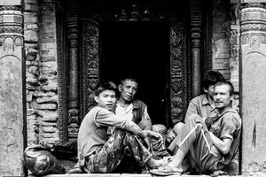 Men spending time together in a small shrine