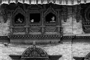 People by the window of Kumari House