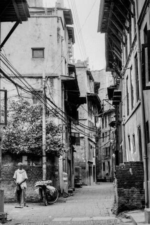 Mango seller standing in street corner