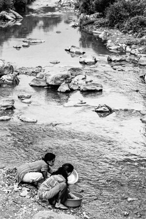 Women washing with river water