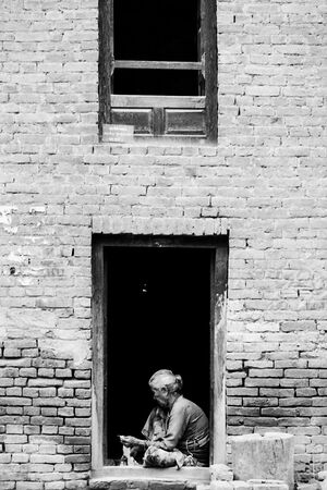 Older woman working at door