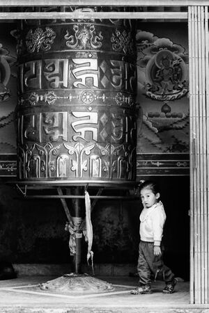 Girl turning around prayer wheel