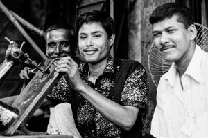 Three man and one sewing machine