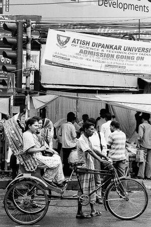 Cycle rickshaw waiting at stop light