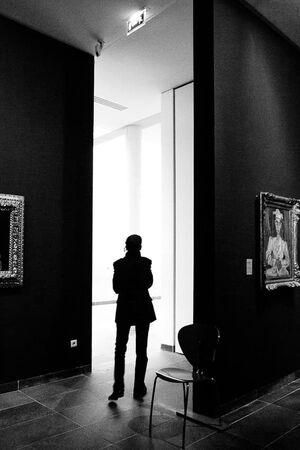 Silhouette walking in Musée de l'Orangerie