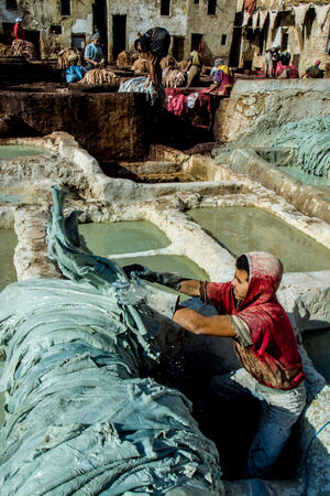 Man working in tanning pit