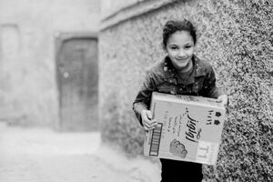 Girl carrying box