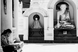 Woman reading book in Shwedagon Paya