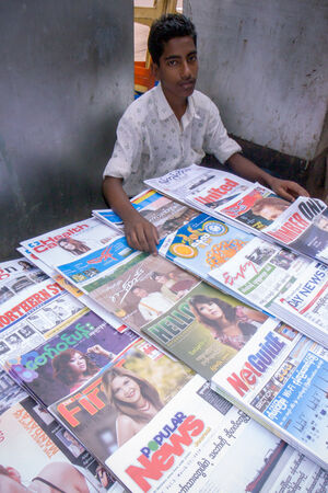 Young man selling magazines