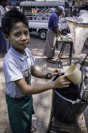 Boy selling drinking water by roadisde