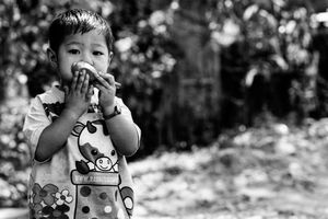 Boy putting spoon to mouth
