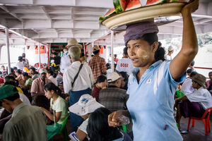Woman selling watermelons on ferry
