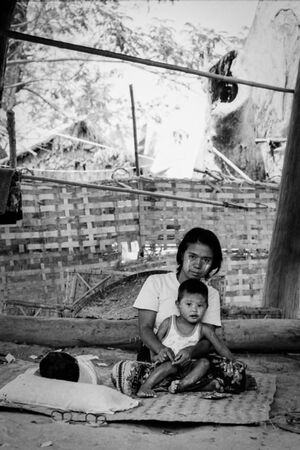 Mother and son sitting under floor