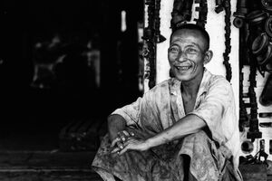 Man sitting in maintenance shop