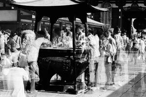 People around incense burner