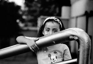 Girl hiding her face