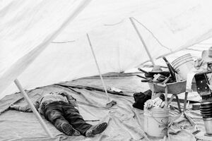Man taking nap in tent