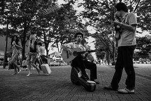 Two guitarists in street