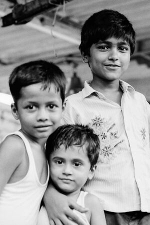 Three boys standing together