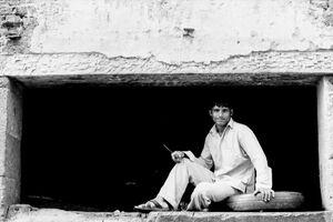 Man sitting at receiving station