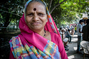 Older woman with deep red Bindi
