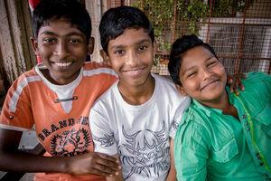 Three boys smiling