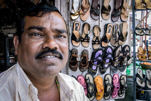 Man working in shoe shop
