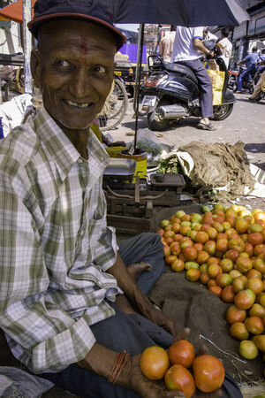 Old man with Tilaka selling tomatoes