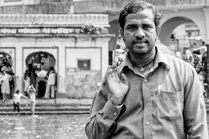 Man standing by Godavari river