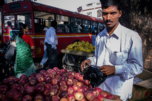 Man selling apples in bus terminal