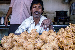 Man selling Pakora in fried food stand