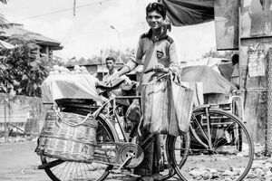 Peddler with bicycle