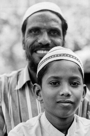 Boy and father wearing Taqiyah