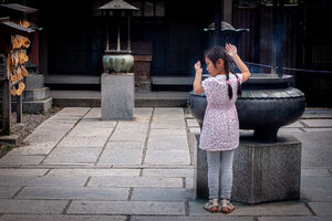 Girl beside incense burner