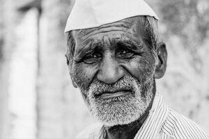 Man wearing Gandhi cap
