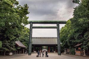 Men in front of Torii