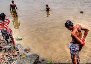 People soaking in Hooghly River