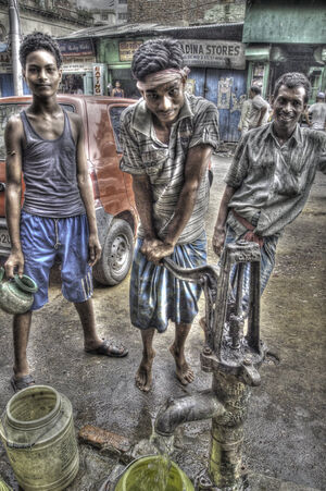 Three men at well