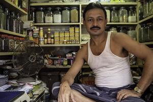 Man working in spice shop
