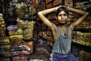 Boy selling biscuits