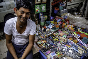 street vendor and his articles for sale