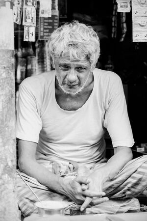 man sitting cross-legged