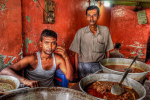 Men selling curry