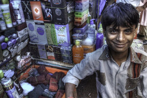 Young man working in street stall
