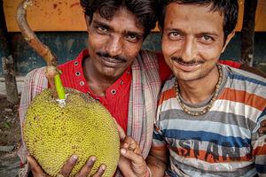 Men holding jackfruit