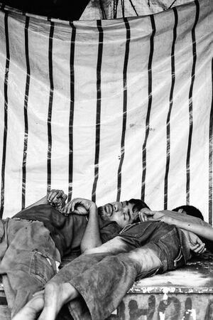 Men sleeping on table