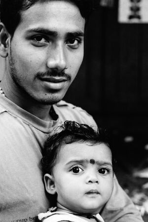 Father and kid with mile-long lashes
