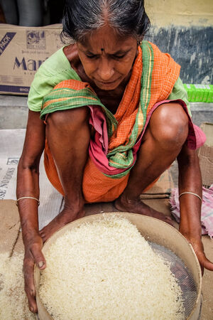Older woman sifting