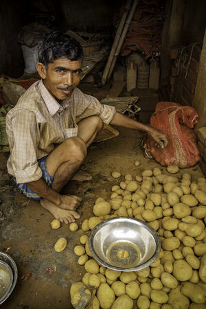 Man selling potatoes