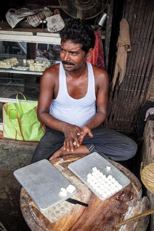 Man rolling doughs
